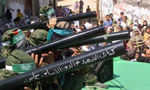 Hamas members display mock rocket launchers during a rally in the a Gazan refugee camp in 2001. Photograph: Mohammed Saber/EPA